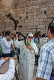 Elderly Jew with a Shofar. JERUSALEM, ISRAEL - OCTOBER 12, 2014: Morning autumn Sukkot. The area in front of Western Wall of  Temple filled with people. Elderly Stock Photos