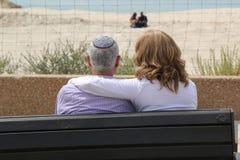 Elderly Jewish couple relax near Mediterranean beach Stock Photography