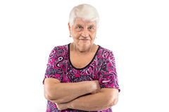 Elderly lady with arms crossed. On white background Royalty Free Stock Photo