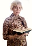 Elderly lady with a book Royalty Free Stock Image