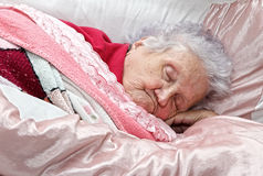 Elderly lady on death bed Stock Photo
