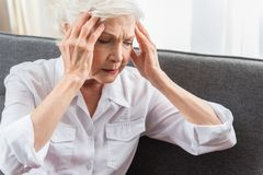 Elderly lady is demonstrating hurt Stock Photos