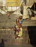 Elderly Lady Descends the Steps stock images