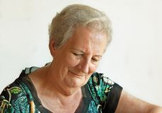 Elderly lady with downcast eyes Royalty Free Stock Photos