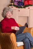 Elderly lady e-book reader Christmas stock image