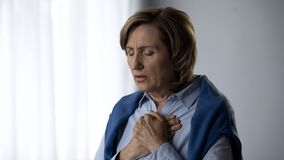 Elderly lady feeling anxiety, disturbed with bad news, emotional experience. Stock photo stock photo