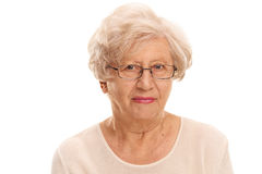 Elderly lady with glasses. Close-up studio shot of an elderly lady with glasses isolated on white background stock image