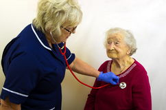 Elderly Lady having Blood Pressure Checked Stock Photos