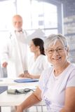 Elderly lady at health control smiling Royalty Free Stock Images