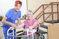 Elderly lady with her physiotherapist in a Royalty Free Stock Photography