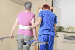 Elderly lady with her physiotherapist in a Stock Image