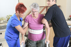 Elderly lady with her physiotherapists in a Stock Image