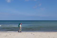 Elderly lady hiking on beach in Denmark Royalty Free Stock Photo