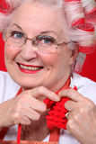 Elderly lady knitting Royalty Free Stock Image