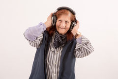 Elderly lady listening music with headphones Stock Photography