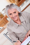 Elderly lady paying bills Royalty Free Stock Image