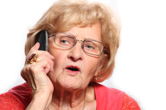 Elderly lady on the phone Stock Images