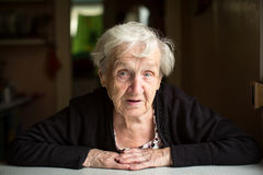 Elderly lady portrait inside the house. Pensioner . Royalty Free Stock Images