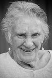 Smiling elderly lady. Portrait of woman laughing in black and white Royalty Free Stock Photos