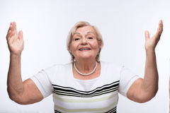 Elderly lady raising hands Royalty Free Stock Images