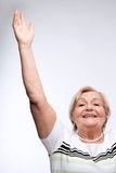Elderly lady raising hands Stock Image