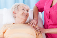Elderly lady during rehabilitation royalty free stock photos