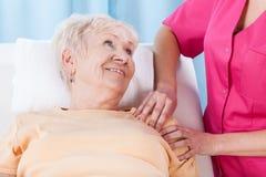 Elderly lady during rehabilitation Royalty Free Stock Photos
