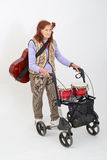 Elderly lady with rollator and musical instruments Stock Photos