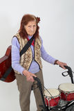 Elderly lady with rollator and musical instruments Stock Photo