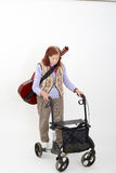 Elderly lady with rollator and musical instruments Royalty Free Stock Image
