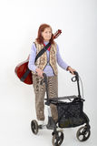 Elderly lady with rollator and musical instruments Stock Images