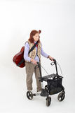 Elderly lady with rollator and musical instruments Royalty Free Stock Photo