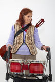 Elderly lady with rollator and musical instruments Royalty Free Stock Images