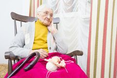 Elderly lady`s time spent well Stock Photos