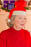 Elderly lady Santa Claus hat Royalty Free Stock Images