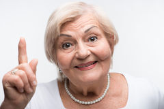 Elderly lady is shaking her finger stock photos