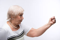 Elderly lady showing her fist stock photo