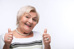 Elderly lady showing her thumbs up Stock Image