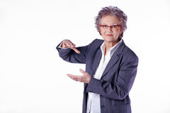 Elderly lady shows the size Royalty Free Stock Photo