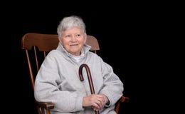 Elderly lady sitting Royalty Free Stock Photography