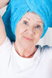 Elderly lady with towel Stock Image