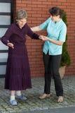 Elderly lady trying to walk Stock Image