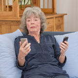Elderly lady with two smartphones Stock Photo