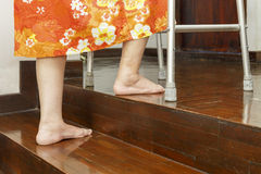 Elderly lady up stairs with walker. At home Royalty Free Stock Images
