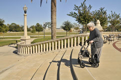 Elderly Lady Vs. Steps Stock Photo