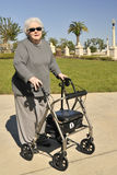 Elderly Lady With Walker Stock Photography