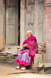 Elderly lady watching a passing ceremony procession. Stock Images