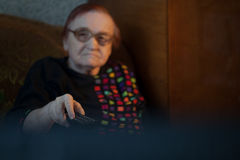 Elderly lady watching television Stock Photography