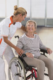 Elderly lady on wheelchair and her care giver. Disabled senior women  her nurse Stock Images