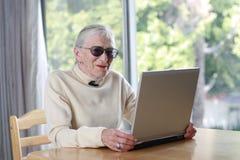 Elderly laptop. Elderly lady with laptop. Shallow DOF Royalty Free Stock Images
